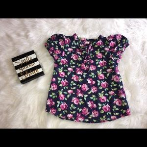 Black blouse with pink flowers